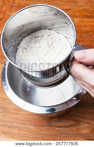 Cooking Of Pie - Sifting The Flour Through Steel Sifter Into Bowl