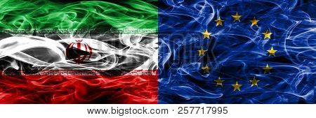 Iran Vs European Union Smoke Flags Placed Side By Side. Thick Colored Silky Smoke Flags Of Iranian A