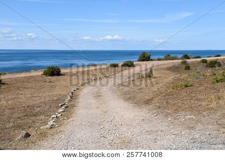 Coastal Gravel Road At The Swedish Island Oland In The Baltic Sea