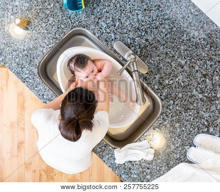 Baby Boy Taking A Bath In A Little Bath Tub