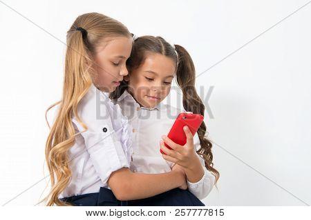 Educational Application. Online Entertainment Concept. Schoolgirls Cute Pupils Use Smartphone Check