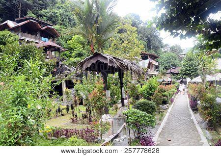 Bukit Lawang Village, Paved Path, And Jungle, Sumatra, Indonesia