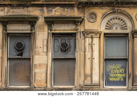 Glasgow, Scotland, Uk - June 17, 2012: What Every Woman Wants Provocative Slogan Painted On Brown Fa