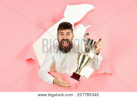 Satisfied Man Celebrating Success. Excited Business Man With Prize Looking Through Hole Paper. Troph