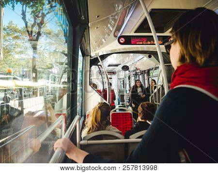 Barcelona, Spain - Nov 12, 2018: Woman Holding Handlebar While Commuting In Public Bus In Barcelona