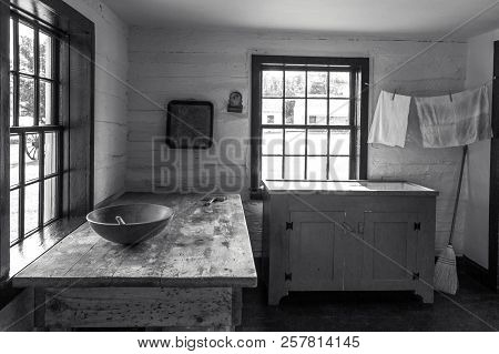 Country Kitchen Interior. Rustic Style Kitchen With Wooden Spoon And Bowl On Antique Wooden Table Wi