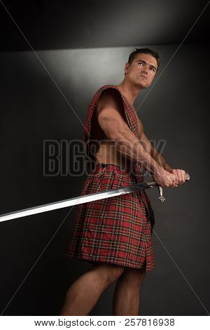 The Sexy Highlander Flexes His Muscles With A Sword