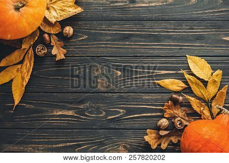 Happy Thanksgiving Concept, Flat Lay. Beautiful Pumpkin With Bright Autumn Leaves, Acorns, Nuts On W