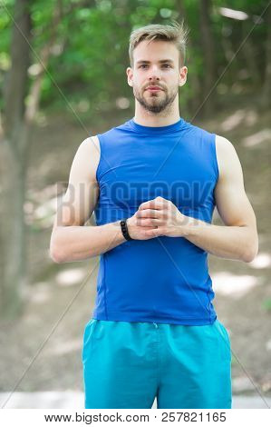 Man Sporty Outfit Looks Confident Outdoors Nature Background. Guy Bearded Muscular Body Proud Of His