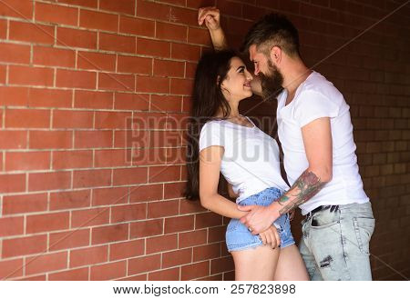 No Rules For Them. Girl And Hipster Full Of Desire Cuddling. Couple In Love Full Of Desire Brick Wal