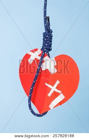 Small Red Heart Shaped Piece Of Paper On Rope. Suicide, Breakup, Bad Relationship, Toxic Romance, Ca