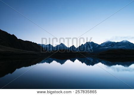 Mountain Lake Koruldi. Morning landscape with clear sky and reflection in water. Main Caucasian ridge. Samegrelo-zemo Svaneti, Georgia