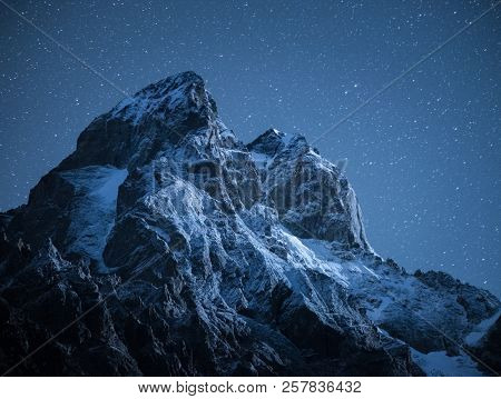 Top Ushba. Mountain peak in the light of the moon. Night landscape with starry sky. Main Caucasian ridge. Samegrelo-zemo Svanetii, Georgia