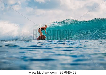 Surf Woman Ride On Surfboard. Woman In Ocean During Surfing. Surfer And Ocean Wave