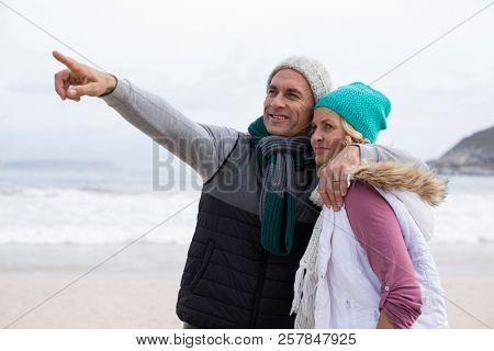 Romantic mature couple embracing each other on the beach