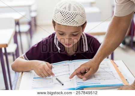 arabic muslim teacher at school