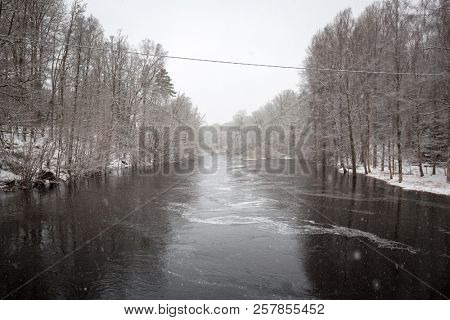 Wild Morrum river in snowy winter, Sweden