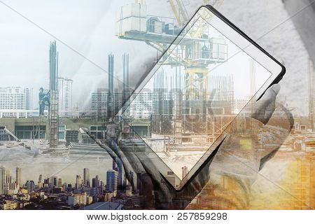 Double Exposure, A Man Using Digital Tablet And Buildings Construction With Cityscape