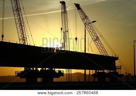 Russia, Crimea Bridge - May 26, 2018: Construction Of Railroad Part Of Crimea Bridge On Sunset, Indu