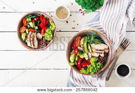 Buddha Bowl Dish With Chicken Fillet, Quinoa, Avocado, Sweet Pepper, Tomato, Cucumber, Radish, Fresh