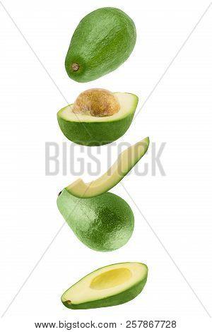 Falling Fresh Avocado Isolated On White Background
