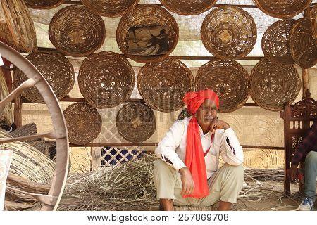 Faridabad, Haryana / India - February 16 2018: Handmade Basket Seller At The Surajkund Crafts Mela -