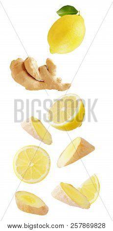 Falling Lemon And Ginger Isolated On White Background
