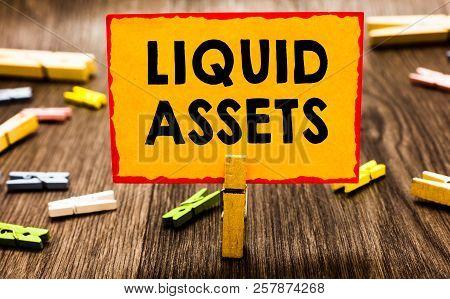 Conceptual Hand Writing Showing Liquid Assets. Business Photo Showcasing Cash And Bank Balances Mark