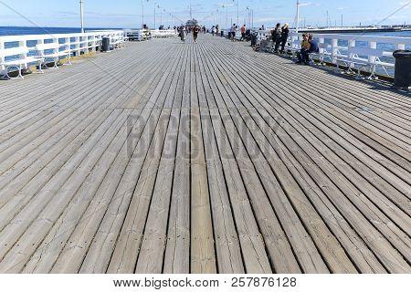 Sopot, Poland - June 6, 2018: Wooden Sopot Pier In Sunny Day. It Is The Longest Wooden Pier In Europ