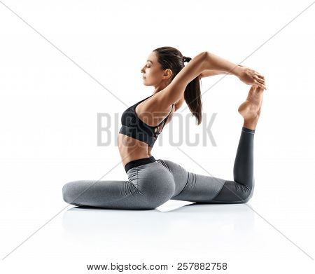 Sporty Young Woman Doing Yoga Practice Isolated On White Background. Concept Of Healthy Life And Nat