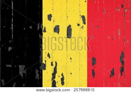 National Flag Of Belgium On The Background Of An Old Mettale Covered With Peeling Paint