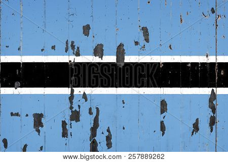 National Flag Of Botswana On The Background Of An Old Mettale Covered With Peeling Paint