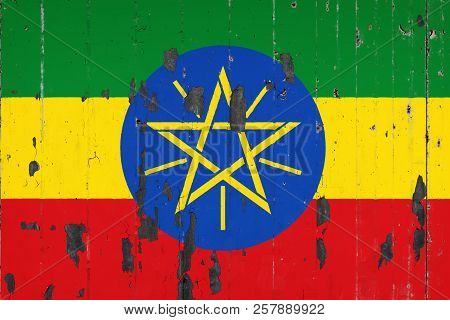 National Flag Of Ethiopia On  The Background Of An Old Mettale Covered With Peeling Paint