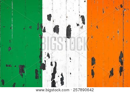 National Flag Of Ireland On The Background Of An Old Mettale Covered With Peeling Paint