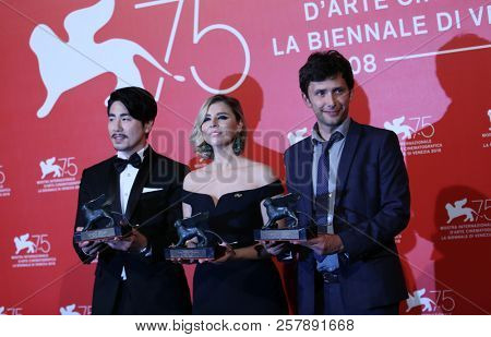 Chuck Chae, Eliza McNitt, Benjamin Nuel pose with the Best VR Experience Award  at the Winners Photocall during the 75th Venice Film Festival at Sala Grande on September 8, 2018 in Venice, Italy.