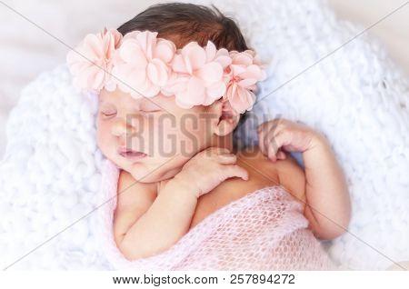 Cute Sleeping Newborn Caucasian Baby Girl A Pink Flower Head Bow. Sweet Infant Girl In Her Sleep. A