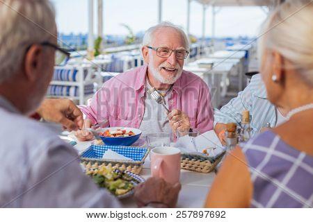 Positive Joyful Nice Man Eating His Meal
