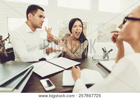 Upset Husband And Angry Wife In Office With Lawyer. Frustrated Husband. Problem In Relationship Betw