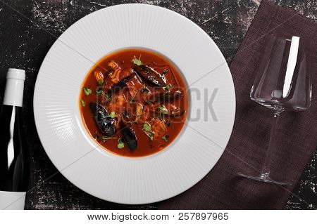 Soup With Seafood And A Bottle Of White Wine