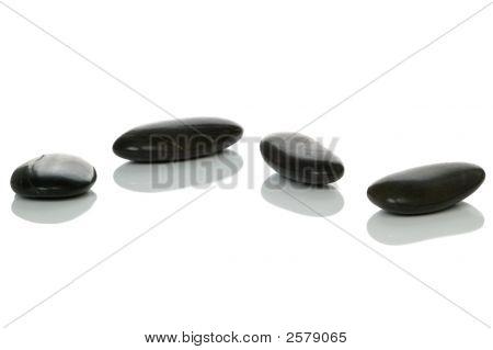 Four Black Pebbles