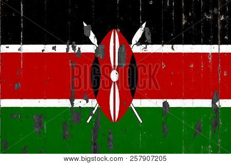 National Flag Of Kenya On The Background Of An Old Mettale Covered With Peeling Paint