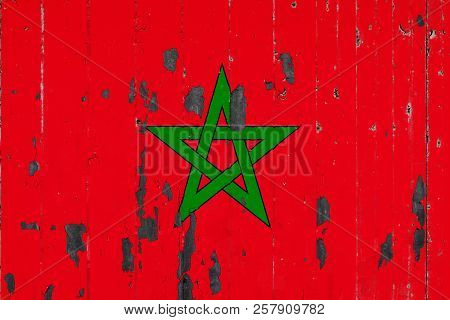 National Flag Of Morocco On The Background Of An Old Mettale Covered With Peeling Paint