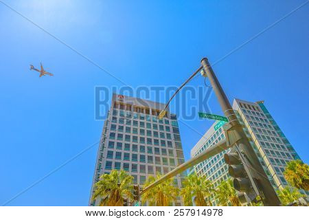 San Jose, United States - August 12, 2018: Adobe Crossroad With An Airplane Flying On Top From San J
