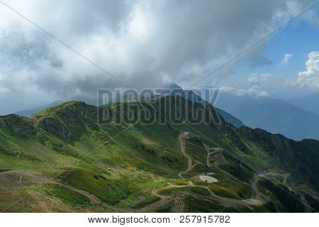 Mountain Is Covered With Lush Forests And Country Roads On The Background Of Sky.