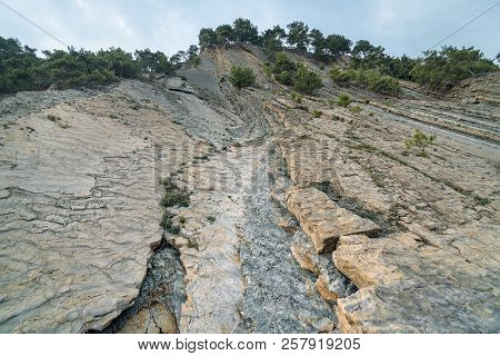 Mountain With Faults After Rockfall Bottom View.