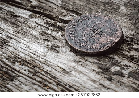 Ancient 5 Kopeks Of Russian Empire On Wooden Table Background.