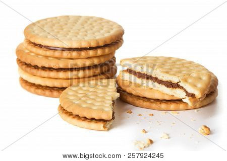Heap Of Sandwich Biscuit Cookies Isolated On White Background