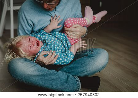 Difficult Parenting - Dad Trying To Comfort Shouting Crying Child
