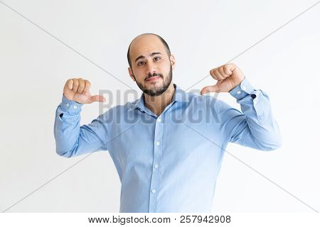 Confident Young Man Pointing At Himself And Looking At Camera. Self-assured Attractive Guy. Self-rel