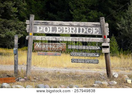 POLEBRIDGE, MONTANA, USA - September 9, 2018: Welcome to Polebridge sign with business advertising signs